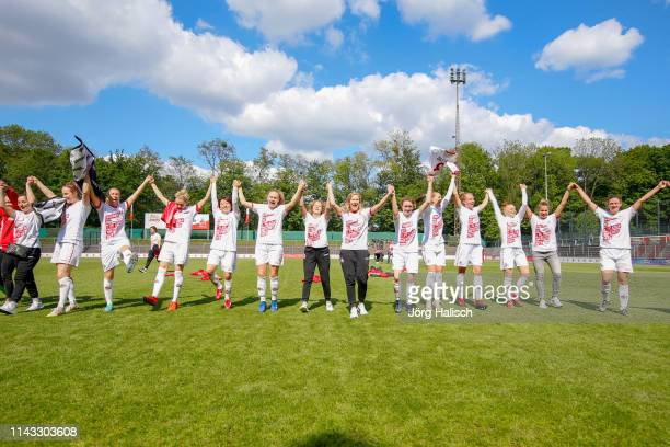The team celebrates the promotion and thanks the fans during the women's second Bundesliga match between 1FC Koeln and 1FC Saarbruecken at...