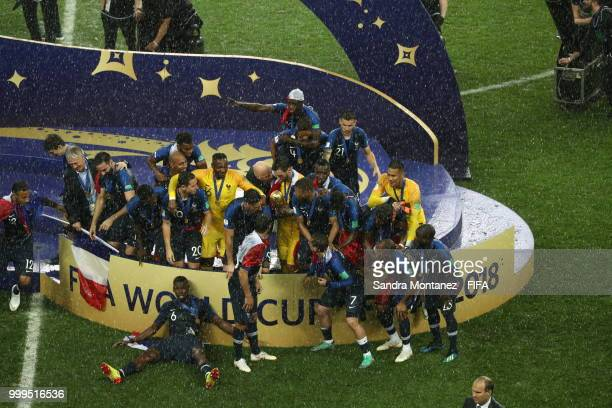 The team celebrates with the World Cup Trophy after winning the 2018 FIFA World Cup Russia Final between France and Croatia at Luzhniki Stadium on...