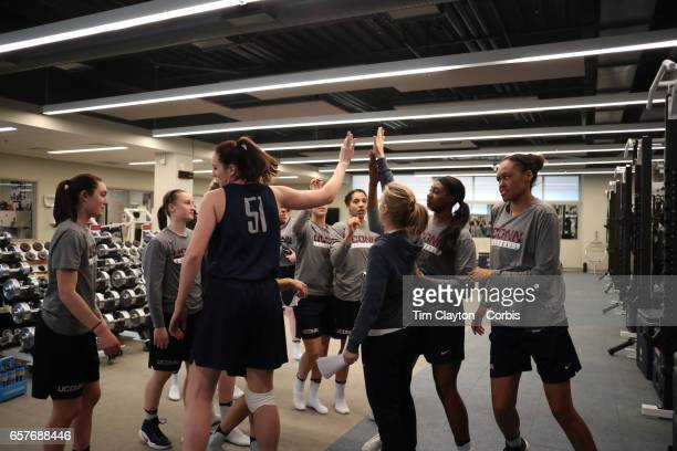 The team come together after warming down and stretching under the supervision of strength coach Amanda Kimball during the'n UConn Huskies women's...