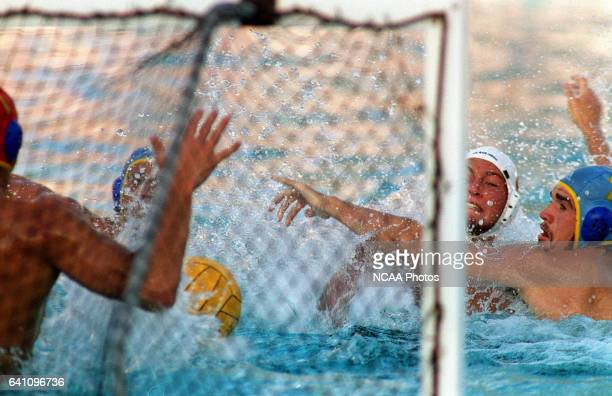 The team defense led here by UCLA's Matt Flesher put the clamps on UCSD's offense during the Division I Men's Water Polo Championship held at Raleigh...