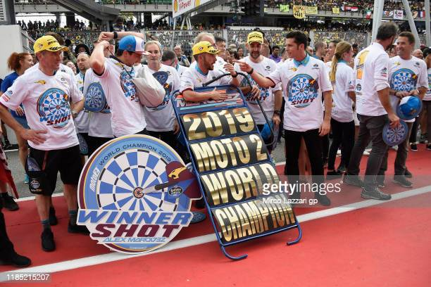The team EG 00 Marc VDS celebrate Alex Marquez of Spain and EG 00 Marc VDS under the podium at the end of the Moto2 race during the MotoGP of...