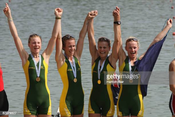 The team from Australia celebrate with their gold medals after the Final A of the women's lightweight quadruple sculls during day six of the FISA...