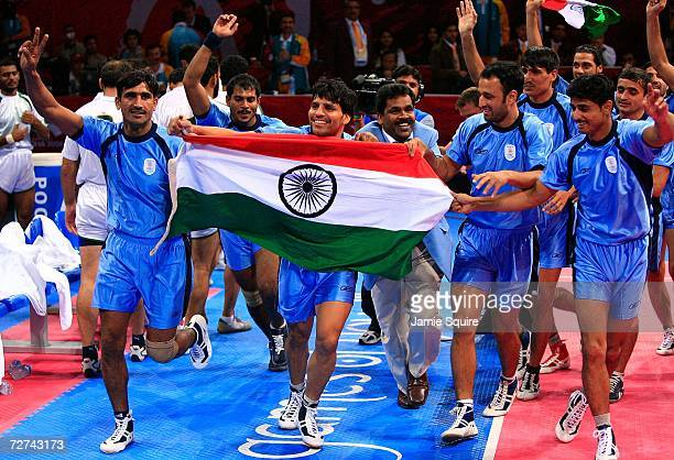 The team from India celebrate their victory over Pakistan to win the gold medal in Men's Kabaddi at the 15th Asian Games Doha 2006 at Aspire Hall on...