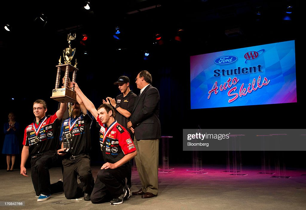 The team from Vale High School, in Vale, Oregon, hold up their first place trophy at the National Finals of the Annual Ford/AAA Student Auto Skills Competition at the Ford Motor Co. World Headquarters in Dearborn, Michigan, U.S., on Tuesday, June 11, 2013. Job openings in the U.S. fell in April, showing companies were waiting to assess the effects of higher taxes and reduced government spending before committing to bigger staff increases. Photographer: Ty Wright/Bloomberg via Getty Images