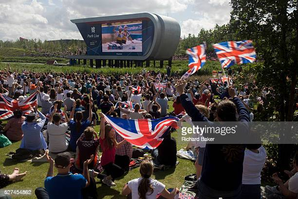 The Team GB slalom canoeists Tim Baillie and Etienne Stott celebrate after their C2 final race watched by celebrating fans in the Olympic Park during...