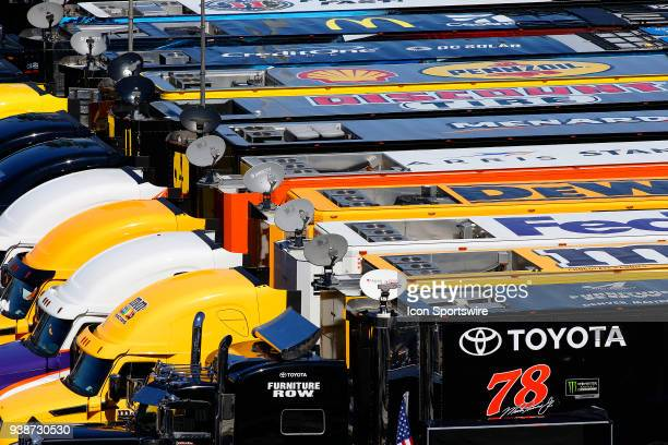 The team haulers sit in the infield during the weather delayed running of the Monster Energy NASCAR Cup Series STP 500 race on March 26, 2018 at the...