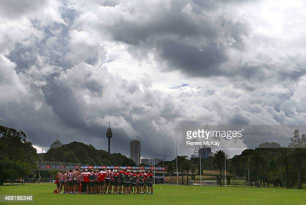 The team huddle during a Sydney Swans AFL training session at Lakeside Oval on March 31 2015 in Sydney Australia