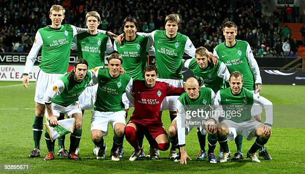 The team line up for a photo before the UEFA Europa League Group L match between Werder Bremen and CD Nacional at Weser Stadium on December 3 2009 in...