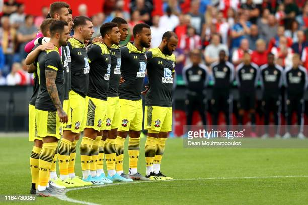 The team line up of Southampton for one minute silence for the lost fans from the last 12 months during the pre season friendly match between...