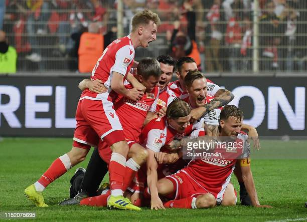 The team of 1 FC Union Berlin celebrates after their promotion to the Bundesliga after the playoff second leg match between 1 FC Union Berlin and VfB...