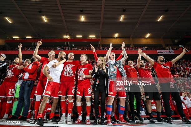 The team of 1. FC Union Berlin celebrates after their promotion to the Bundesliga after the playoff second leg match between 1. FC Union Berlin and...