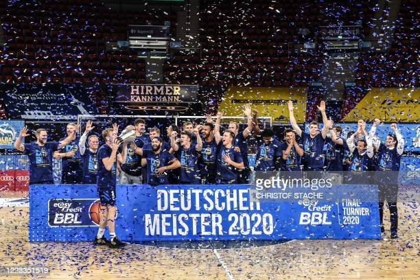 The team of Alba Berlin celebrates with the trophy after the German basketball Bundesliga final second-leg match between MHP Riesen Ludwigsburg and...