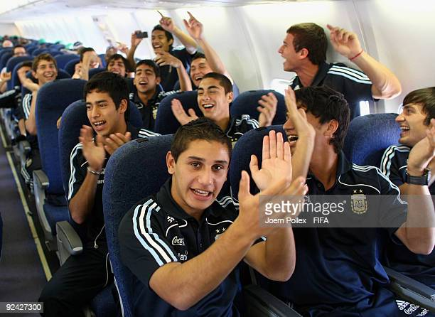 The team of Argentina celebrate on an airplane on their way to Bauchi on October 28 2009 in Bauchi Nigeria