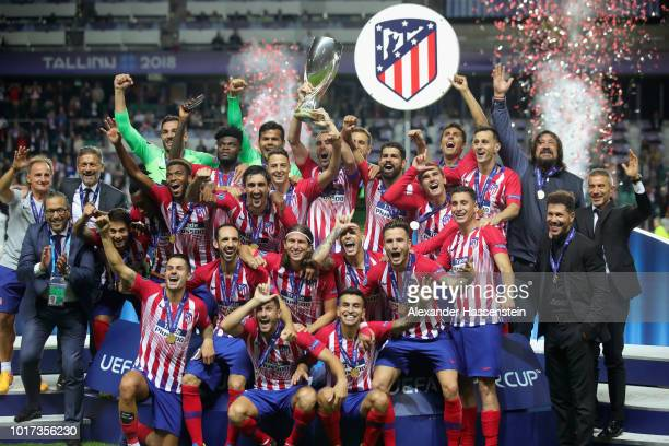 The team of Atletico Madrid celebrates with the trophy following the UEFA Super Cup between Real Madrid and Atletico Madrid at Lillekula Stadium on...