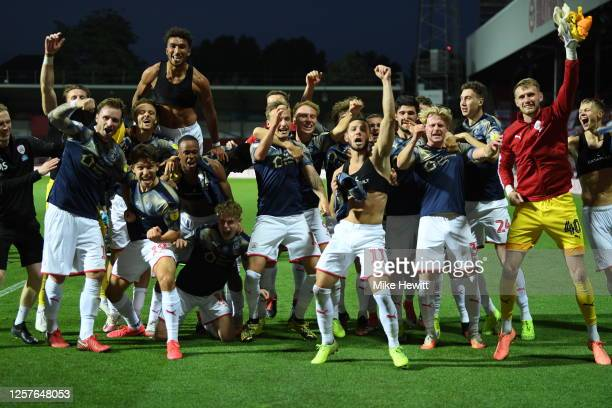 The team of Barnsley celebrate staying up after the Sky Bet Championship match between Brentford and Barnsley at Griffin Park on July 22, 2020 in...