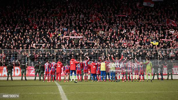 The team of Bayern celebrates after the Regionalliga Bayern match between Bayern Muenchen II and TSV 1860 Muenchen II at Stadion an der Gruenwalder...