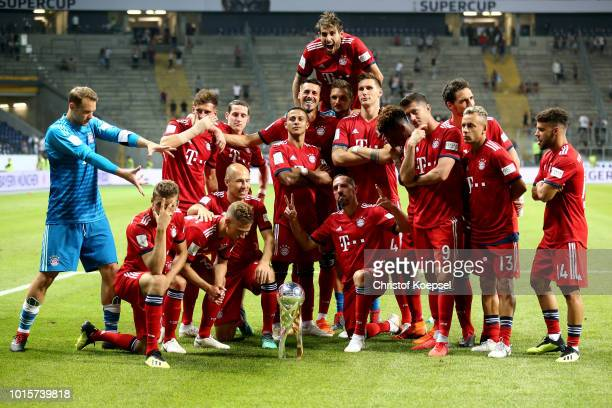The team of Bayern celebrates after winning 50 the DFL Supercup match between Eintracht Frankfurt an Bayern Muenchen at CommerzbankArena on August 12...