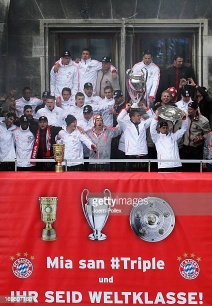 The team of Bayern Muenchen celebrate winning Bundesliga Champions League and DFB Cup on the town hall balcony at Marienplatz on June 2 2013 in...