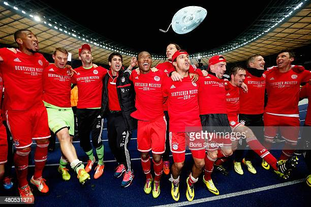The team of Bayern Muenchen celebrate winning the German Championship after the Bundesliga match between Hertha BSC and FC Bayern Muenchen at...