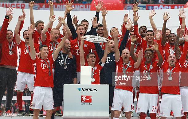The team of Bayern Muenchen celebrates with the German Championship trophy after the Bundesliga match between FC Bayern Muenchen and Hannover 96 at...