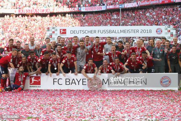 The team of Bayern Muenchen celebrates with the trophy winning the Germany Champiosnhip 2017/2018 after the Bundesliga match between FC Bayern...