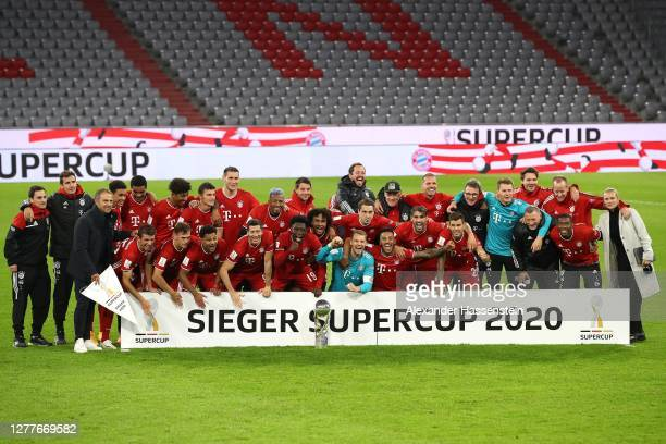 The team of Bayern Munich celebrate with the Supercup Trophy after the Supercup 2020 match between FC Bayern Muenchen and Borussia Dortmund at...