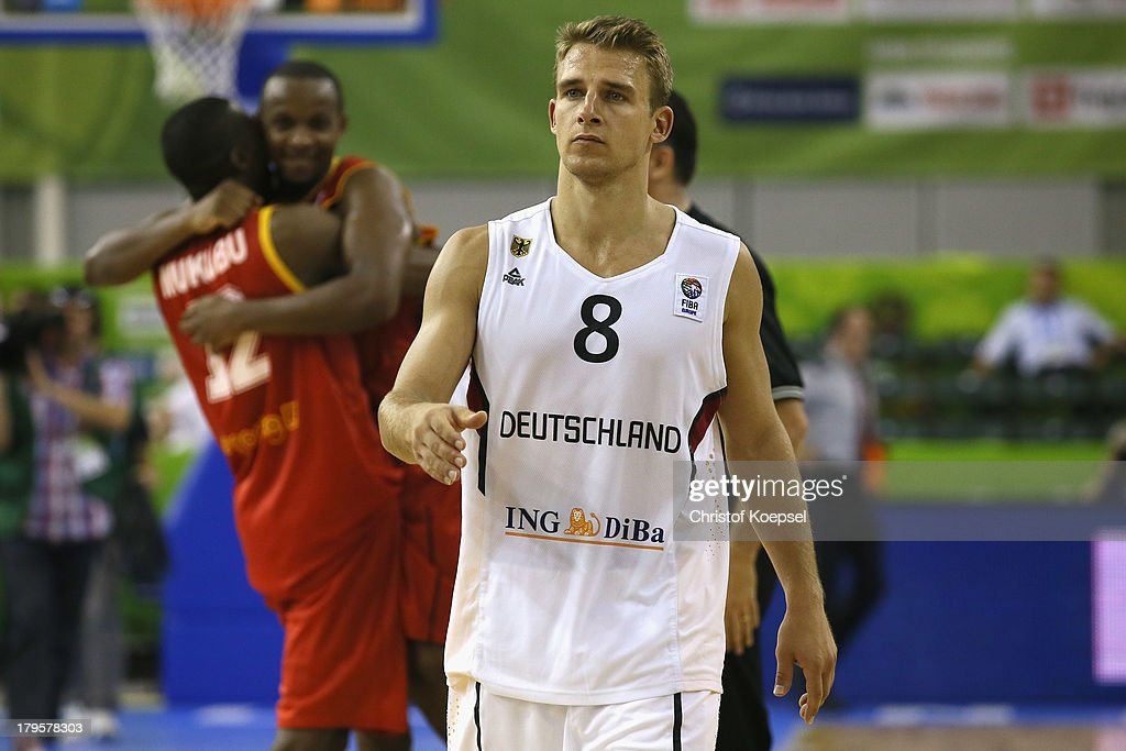 The team of Belgium celebrates and Heiko Schaffartzik of Gemany looks dejected after the FIBA European Championships 2013 first round group A match between Germany and Belgium at Tivoli Arena on September 5, 2013 in Ljubljana, Slovenia. The match between Germany and Belgium ended 73-77 after extra time.