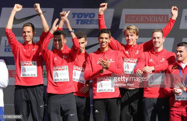 The team of Belgium gold pose with their medals for the Men's 4x400 metres Relay during day six of the 24th European Athletics Championships at...