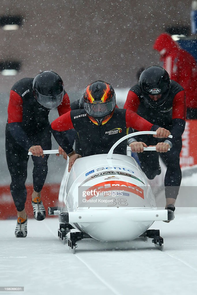 The team of Belgium with Michael Serise, Sebastien Trouillez, Lino Vandoorne and Korneel Deblock sprint during the four men's bob competition during the FIBT Bob & Skeleton World Cup at Bobbahn Winterberg on December 9, 2012 in Winterberg, Germany.
