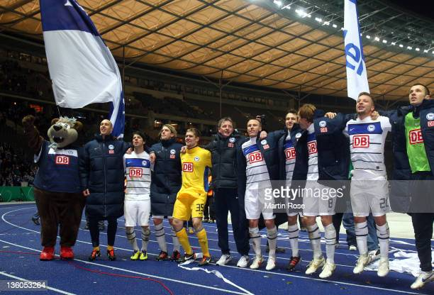The team of Berlin celebrate after winning the DFB Cup round of sixteen match between Hertha BSC Berlin and 1. FC Kaiserslautern at Olympic stadium...