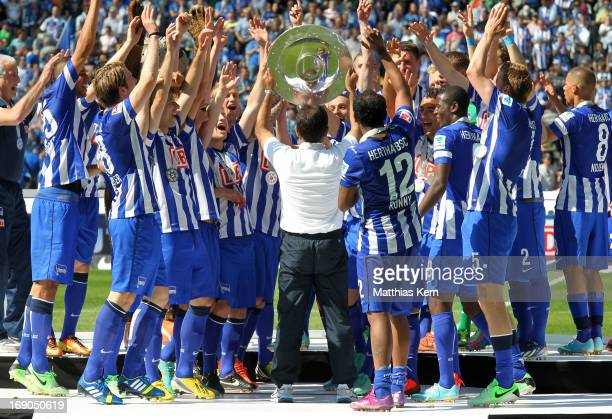 The team of Berlin celebrate with the cup after winning the championship after the Second Bundesliga match between Hertha BSC Berlin and FC Energie...
