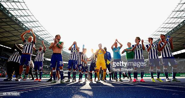 The team of Berlin celebrate with their fans after winning the Bundesliga match between Hertha BSC and Vfb Stuttgart at Olympiastadion on September...