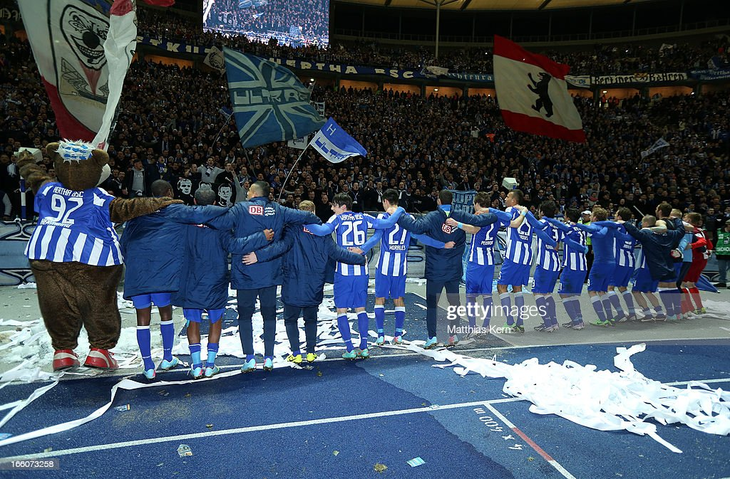 The team of Berlin celebrate with their supporters after winning the Second Bundesliga match between Hertha BSC Berlin and Eintracht Braunschweig at Olympic stadium on April 8, 2013 in Berlin, Germany.