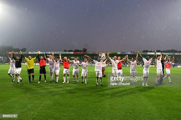 The team of Berlin celebrates after winning the Second Bundesliga match between 1. FC Union Berlin and Hansa Rostock at the stadium An der Alten...