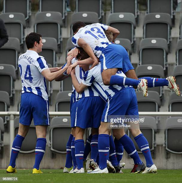 The team of Berlin celebrates the third goal during the DFB Juniors Cup half final between Hertha BSC Berlin and VfL Bochum at the Amateurstadion of...