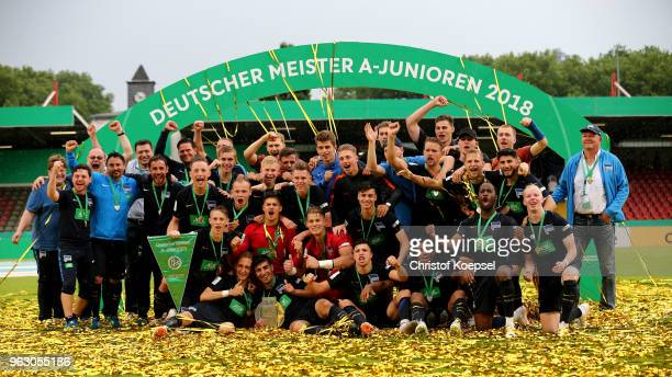 The team of Berlin celebrates with the German trophy after winning 31 the German A Juniors Championship Final between FC Schalke 04 U19 and Hertha...