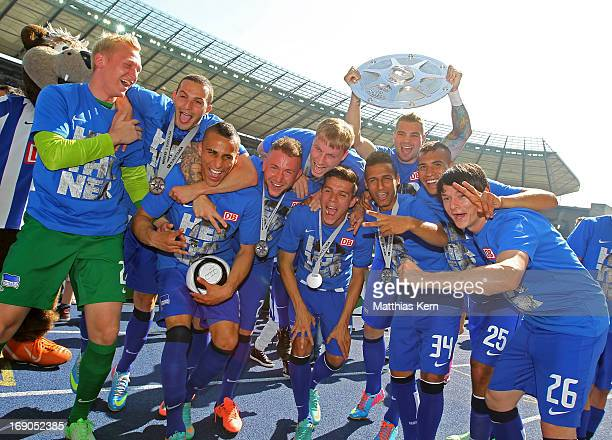 The team of Berlin pose with the cup after winning the championship after the Second Bundesliga match between Hertha BSC Berlin and FC Energie...