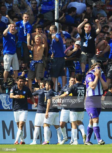 The team of Bochum celebrates after Mahir Saglik scored his team's third goal during the Second Bundesliga match between VfL Osnabrueck and VfL...