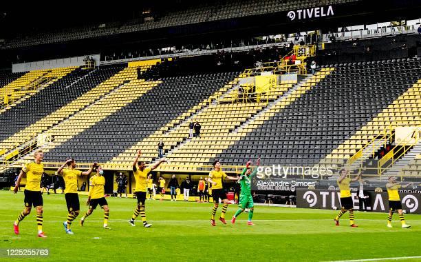 The team of Borussia Dortmund celebrates after the Bundesliga match between Borussia Dortmund and FC Schalke 04 at Signal Iduna Park on May 16 2020...