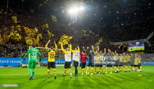 The team of Borussia Dortmund celebrates the win after the final whistle during the Bundesliga match between Borussia Dortmund and FC Bayern Muenchen...
