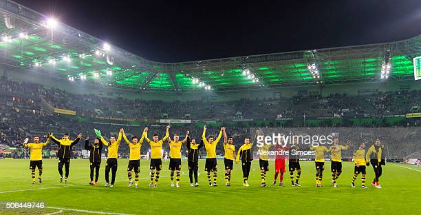The team of Borussia Dortmund celebrates the win after the final whistle during the Bundesliga match between Borussia Moenchengladbach and Borussia...