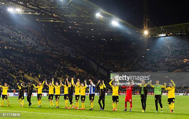 The team of Borussia Dortmund celebrates the win after the final whistle together with their fans during the UEFA Europa League Round of 32 First Leg...