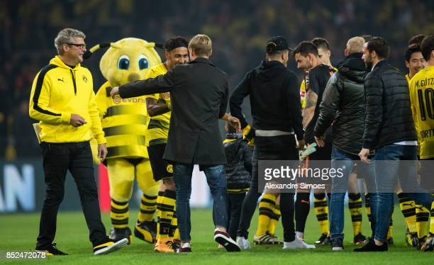 The team of Borussia Dortmund celebrates the win after the final whistle during the Bundesliga match between Borussia Dortmund and Borussia...