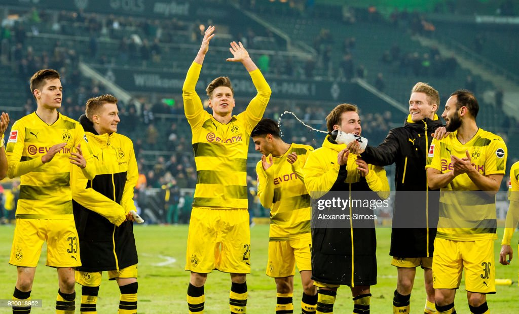 The team of Borussia Dortmund celebrates the win after the final whistle during the Bundesliga match between Borussia Moenchengladbach and Borussia Dortmund at the Borussia-Park on February 18, 2018 in Moenchengladbach, Germany.