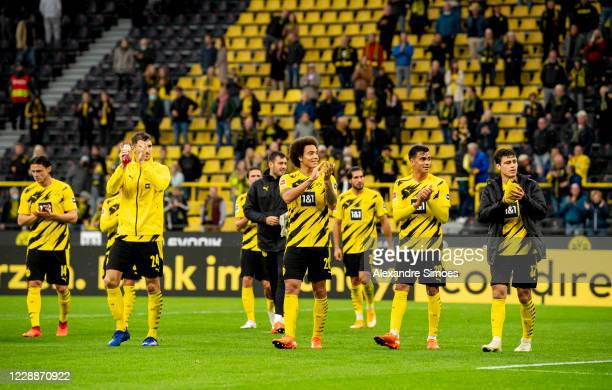 The team of Borussia Dortmund celebrates the win together with the fans after the final whistle during the Bundesliga match between Borussia Dortmund...