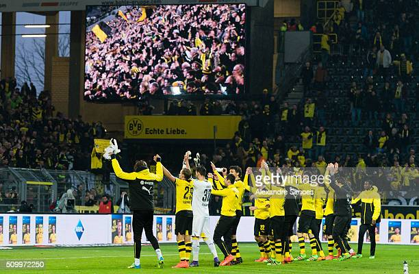 The team of Borussia Dortmund celebrates the win together with their fans after the final whistle during the Bundesliga match between Borussia...