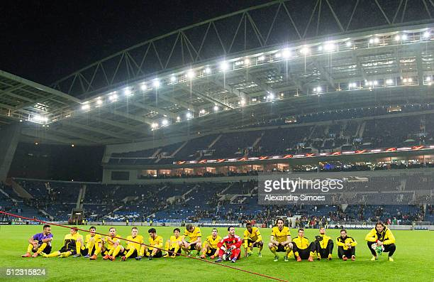 The team of Borussia Dortmund celebrates the win together with their fans after the final whistle during the UEFA Europa League Round of 32 Second...