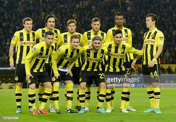 The team of Borussia Dortmund Dortmund's midfielder Moritz Leitner, striker Marco Reus, defender Marcel Schmelzer, midfielder Ilkay Guendogan,...