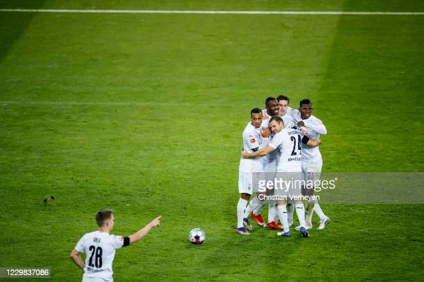 The Team of Borussia Moenchengladbach celebrate after Marcus Thuram scored his teams third goal during the Bundesliga match between Borussia...