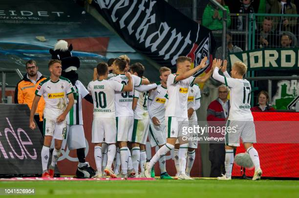 The Team of Borussia Moenchengladbach celebrate after Nico Elvedi scores his teams third goal during the Bundesliga match between Borussia...